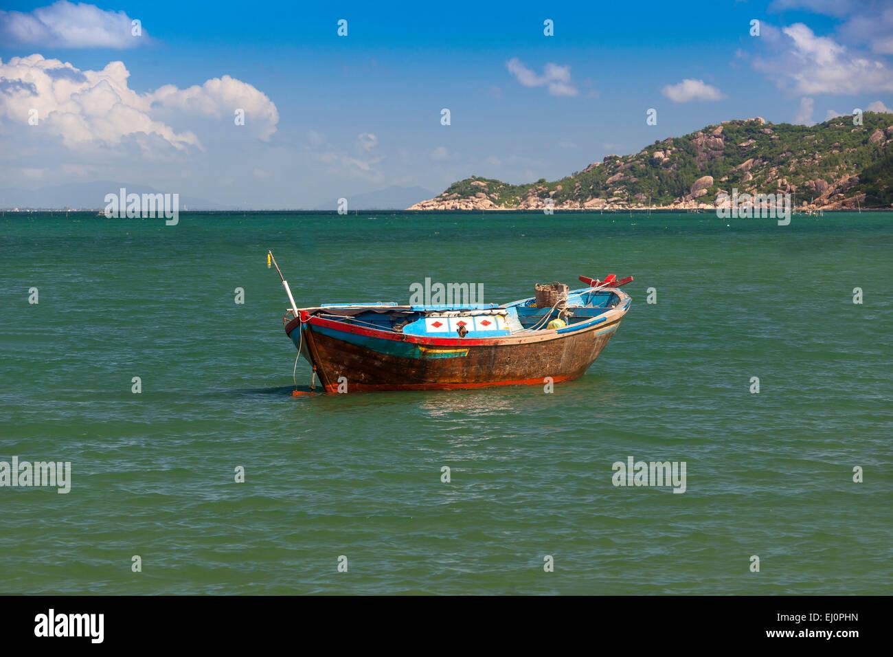 Fishing boat, Hon, Mun, bay, Vinpearl, island, South China Sea, sea, Asian, Asia, outside, mountains, mountainous, - Stock Image