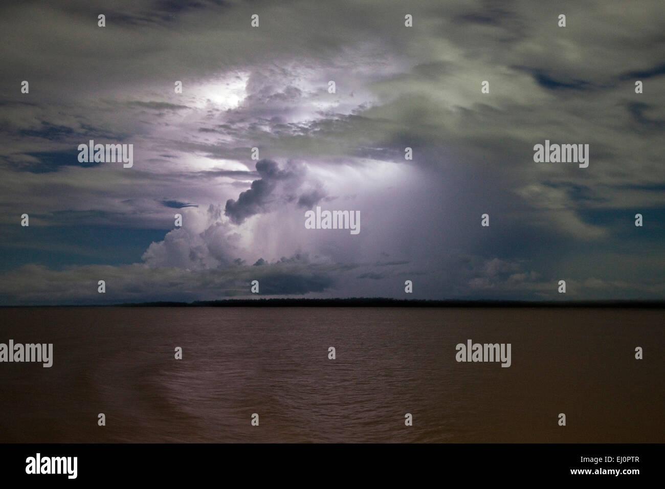 sheet lightning, storm, stormy, clouds, cloudy, lighting, lights up, night sky, Amazon River, Amazonas, Brazil, - Stock Image