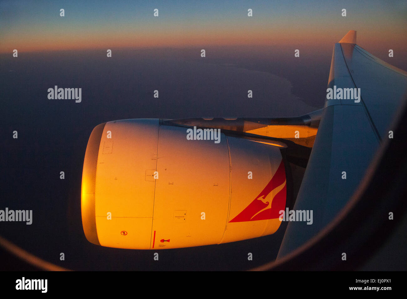 Flight, Flying, jet, engine, Quantas, orange, sky, horizon, wing, plane, airplane, travel, holidays, - Stock Image
