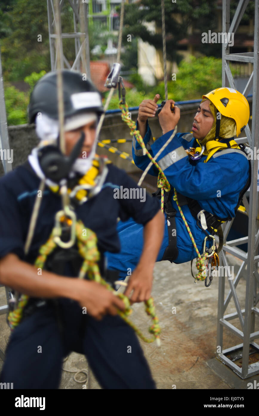 Rope access training in Jakarta. - Stock Image