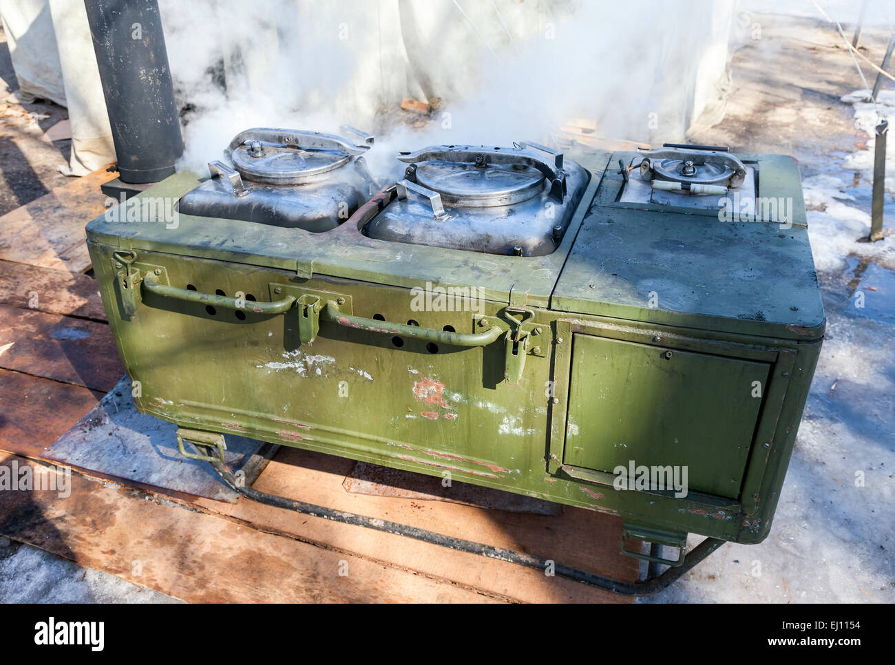 Mobile metal kitchen stove to feed soldiers Stock Photo