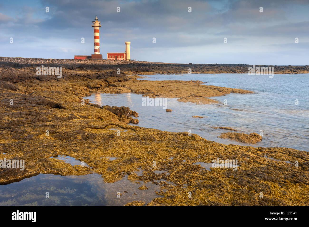 Faro de El Toston, Spain, Europe, Canary islands, Fuerteventura, coast, rock, cliff, lighthouse - Stock Image