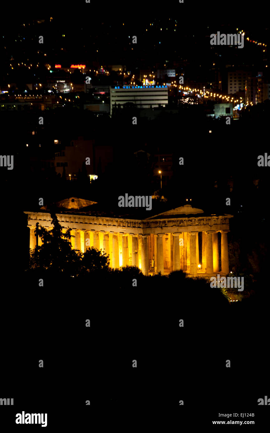 The Temple of Hephaestus at night in The Agora of Athens in Athens, Greece. - Stock Image