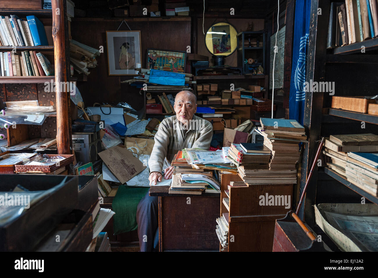 Kyoto, Japan. A secondhand book and print dealer in his old shop in a quiet back street - Stock Image