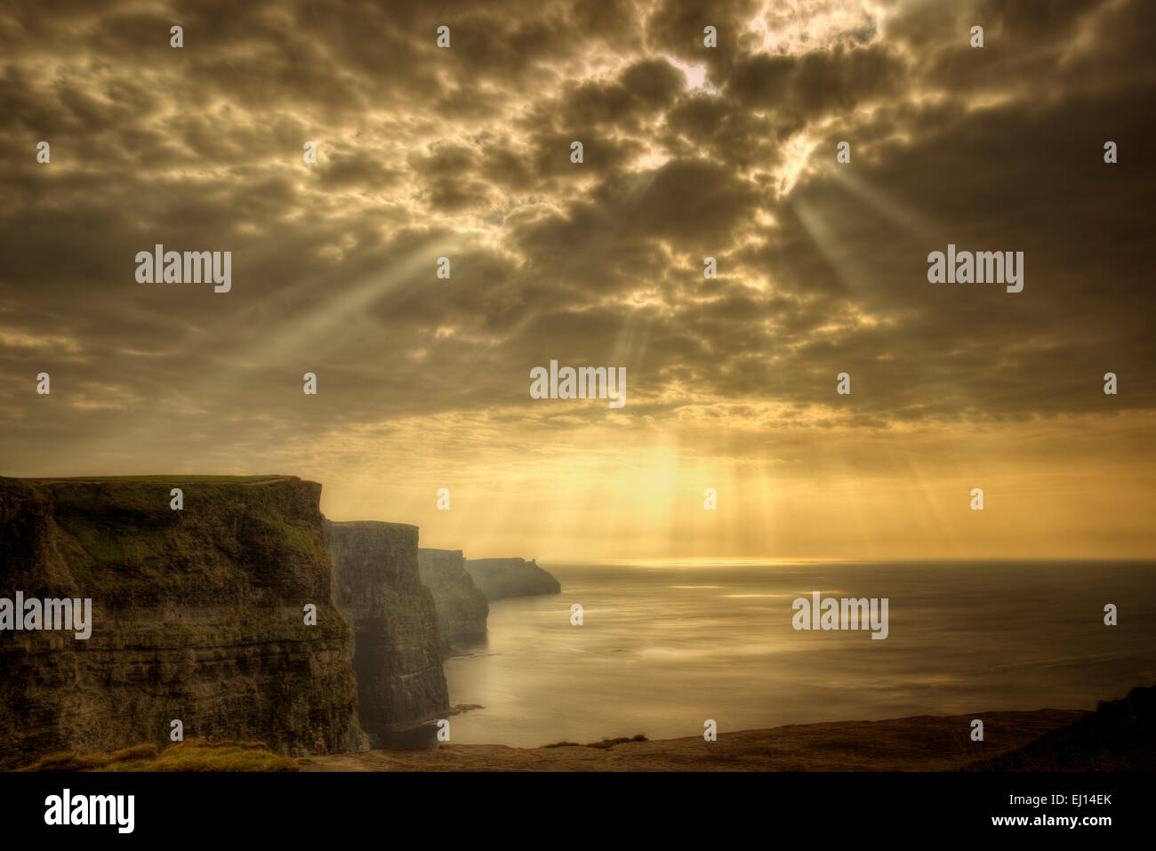 Cliffs of Moher with Gods rays Ireland - Stock Image