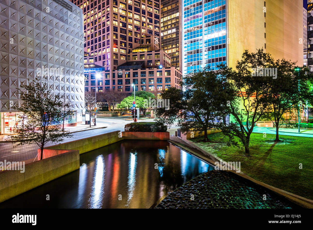 Buildings and pond at Thanks-Giving Square at night in Dallas, Texas. - Stock Image