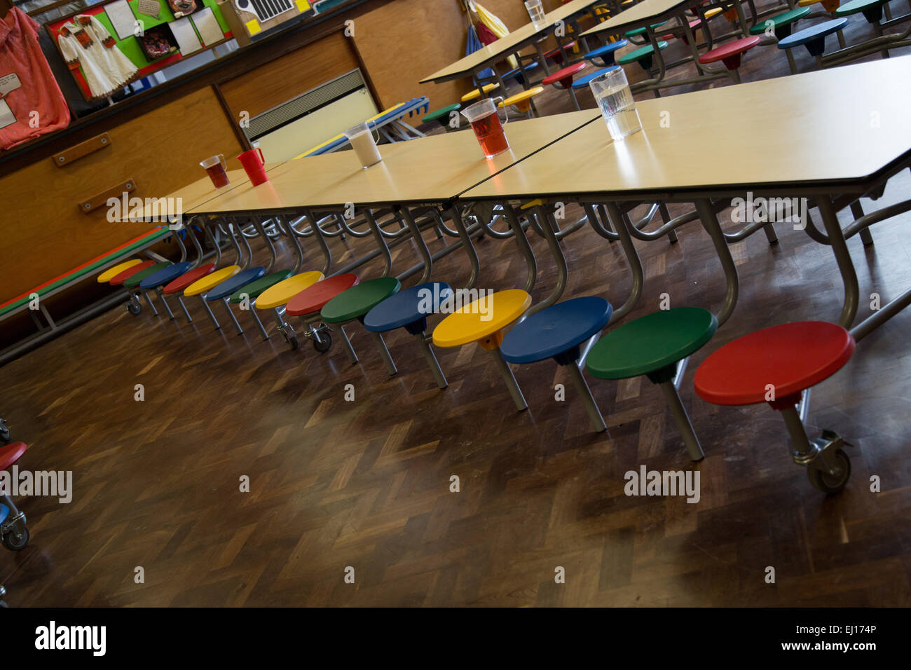 Empty UK school dining hall ready for school lunch - Stock Image
