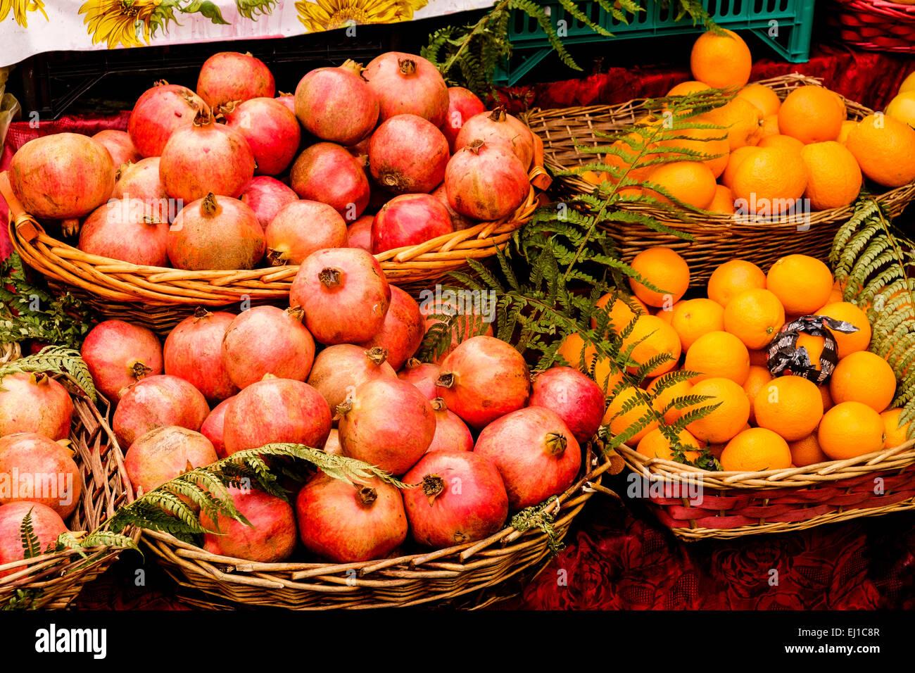 Pomegranates and oranges on sale at Campo de Fiori market  in Rome Italy - Stock Image