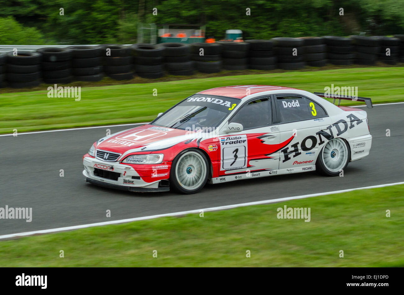 Dodd drives a classic Honda competes in a Classic Touring cars race at Oulton Park race circuit - Stock Image