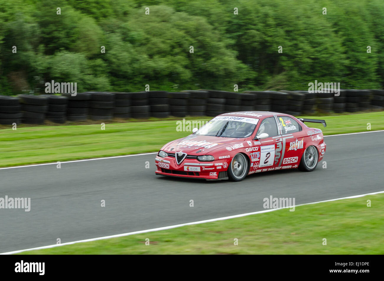A classic Alfa Romeo competes in a Classic Touring cars race at Oulton Park race circuit - Stock Image