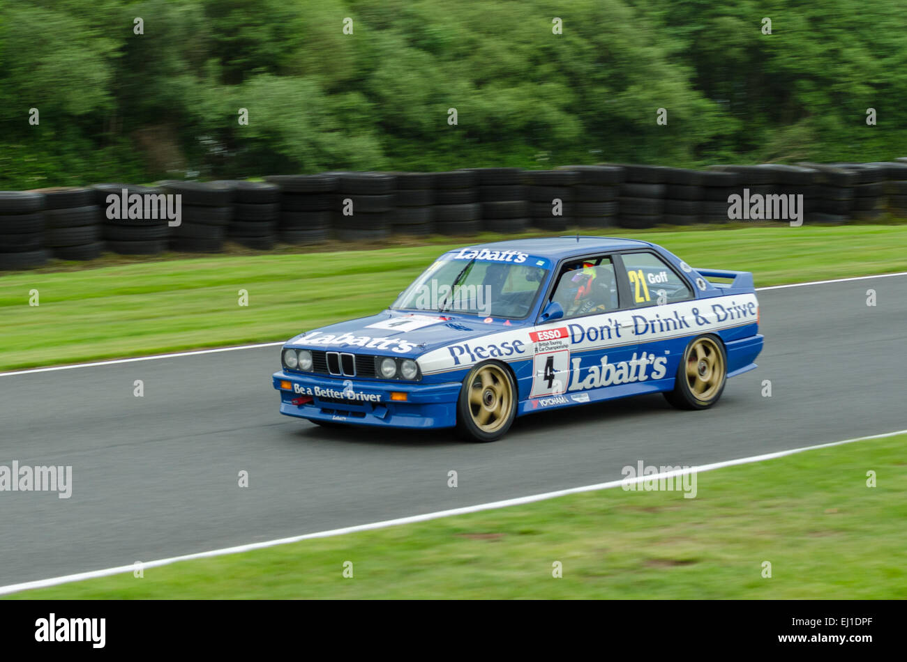 A classic BMW competes in a Classic Touring cars race at Oulton Park race circuit - Stock Image
