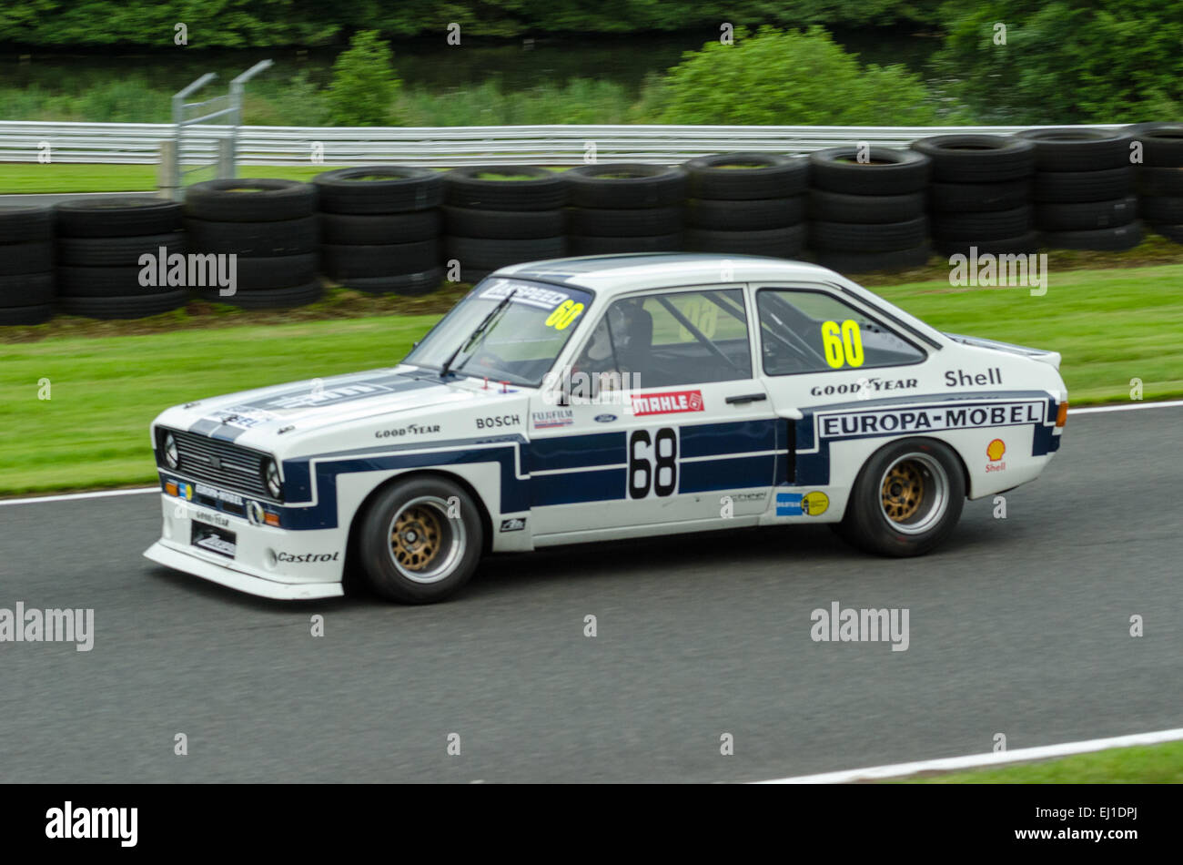A classic car competes in a Classic Touring cars race at Oulton Park race circuit - Stock Image