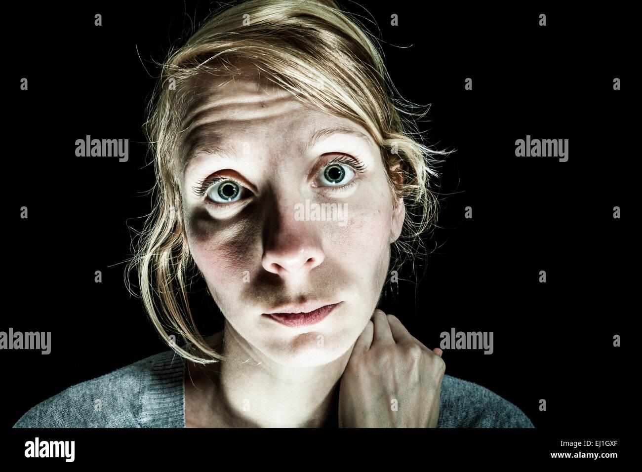 Insomniac Sad and Hopelessness Woman needing Help - Isolated on Black - Stock Image