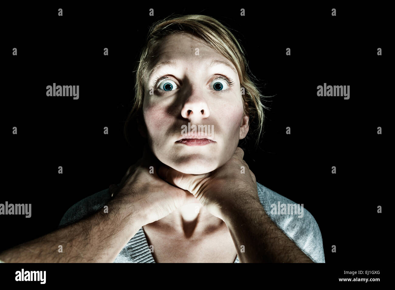Woman Victim Being Strangle by her Boyfriend - Domestic Violence Concept - Stock Image