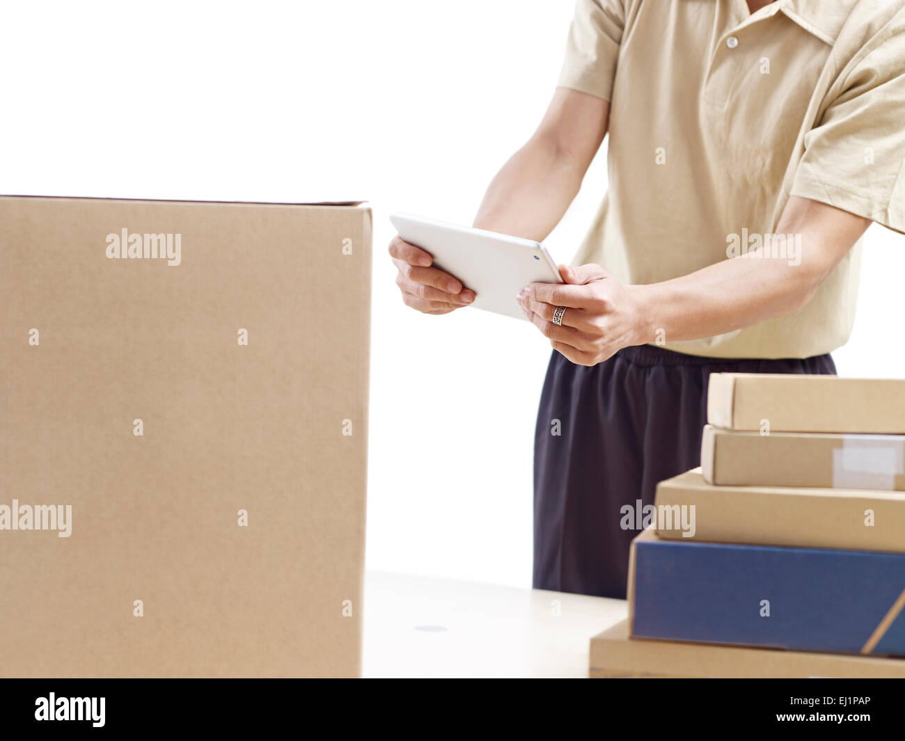 warehouse man working using tablet computer. - Stock Image