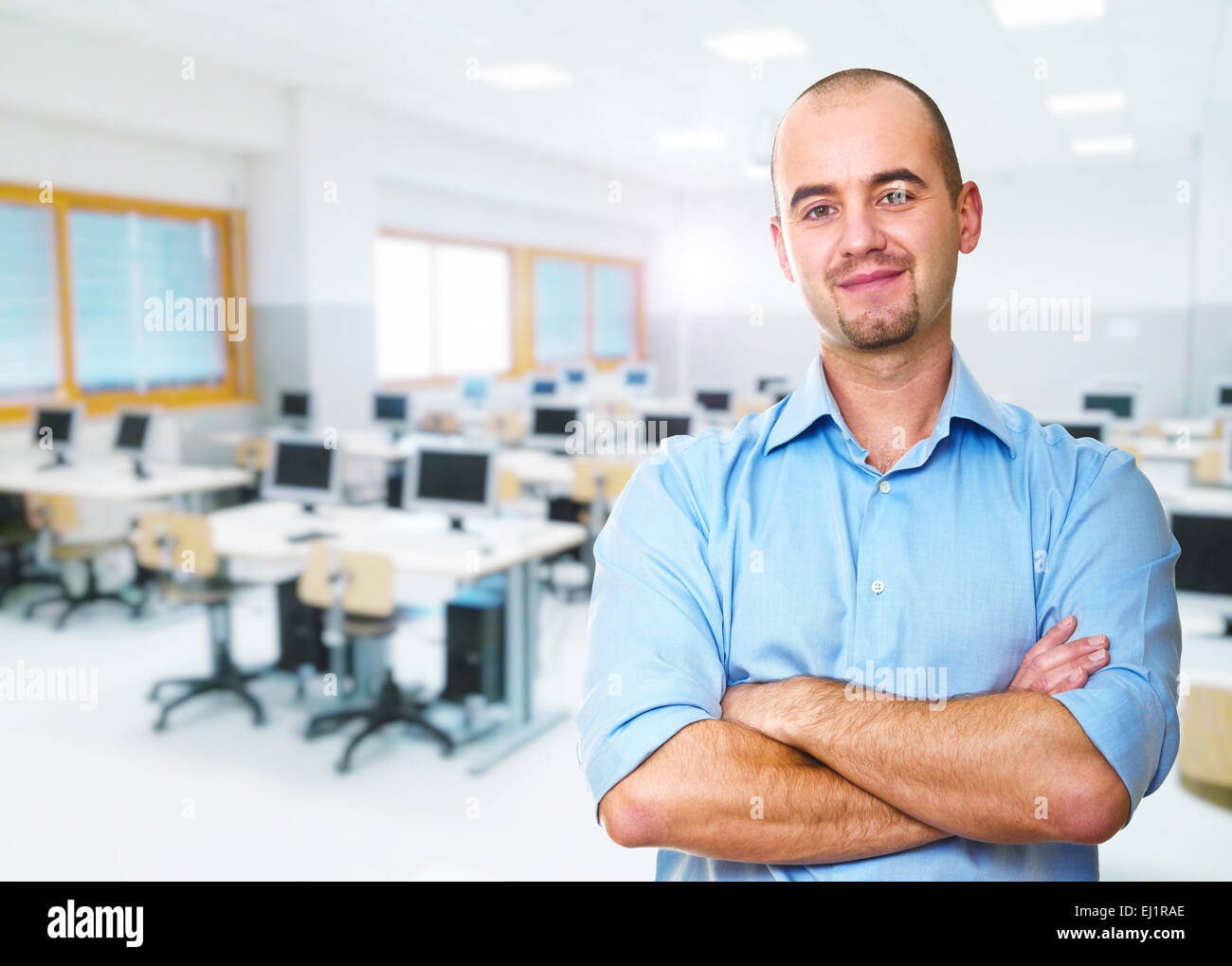 portrait of teacher and classroom background - Stock Image