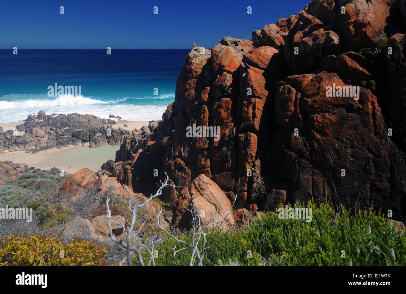 Trail between rocks down to Injidup Beach, Margaret River region, Western Australia Stock Photo