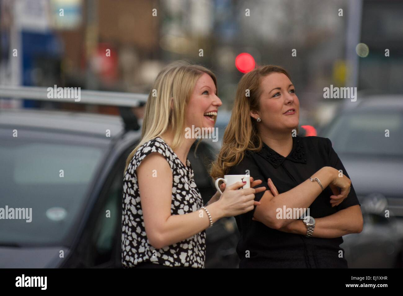 Manchester UK  20th March  2015 Two young lasdes watch the solar eclipse without eye protection in Didsbury, South - Stock Image