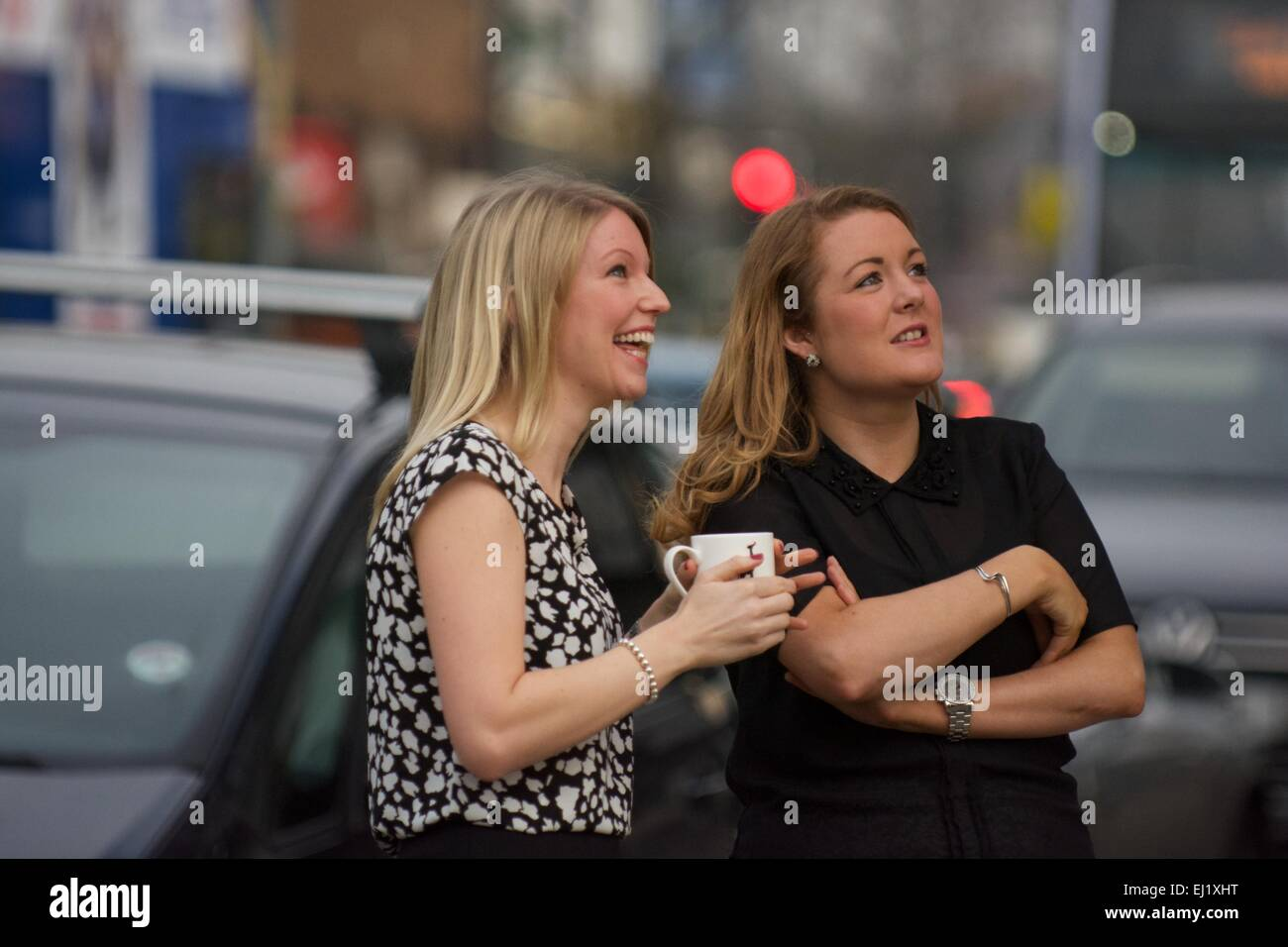 Manchester UK  20th March  2015 Two young ladies watch the solar eclipse without eye protection in Didsbury, South - Stock Image