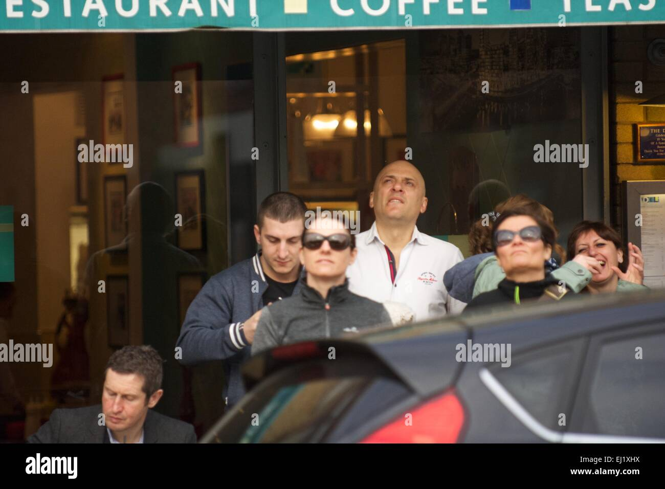 Manchester UK  20th March  2015 People watch the solar eclipse , some without eye protection, in Didsbury, South - Stock Image