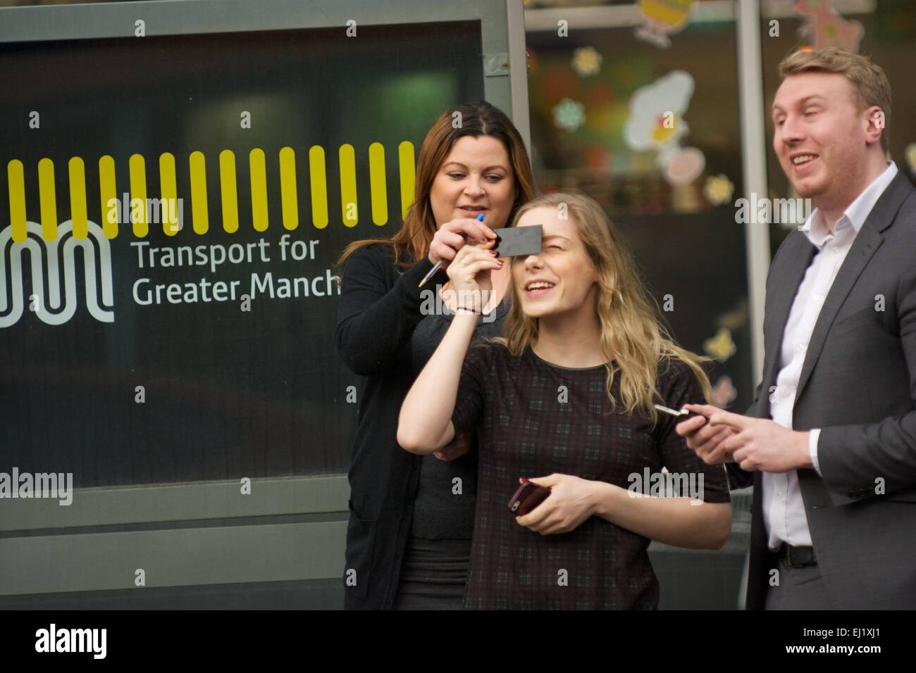 Manchester UK  20th March  2015 Three people , one with eye protection, watch the solar eclipse in Didsbury, South - Stock Image