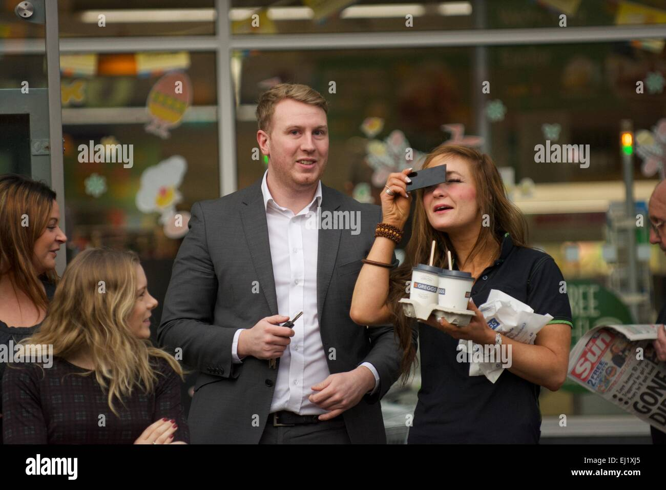 Manchester UK  20th March  2015 Four people , one with eye protection, watch the solar eclipse in Didsbury, South - Stock Image