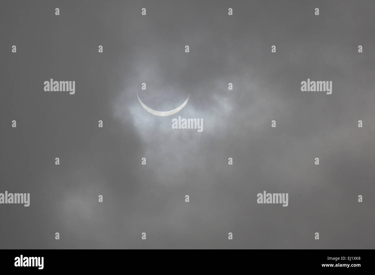 The solar eclipse in Sunderland, England. Grey clouds obscure the view of the sun. Credit:  Stuart Forster/Alamy - Stock Image