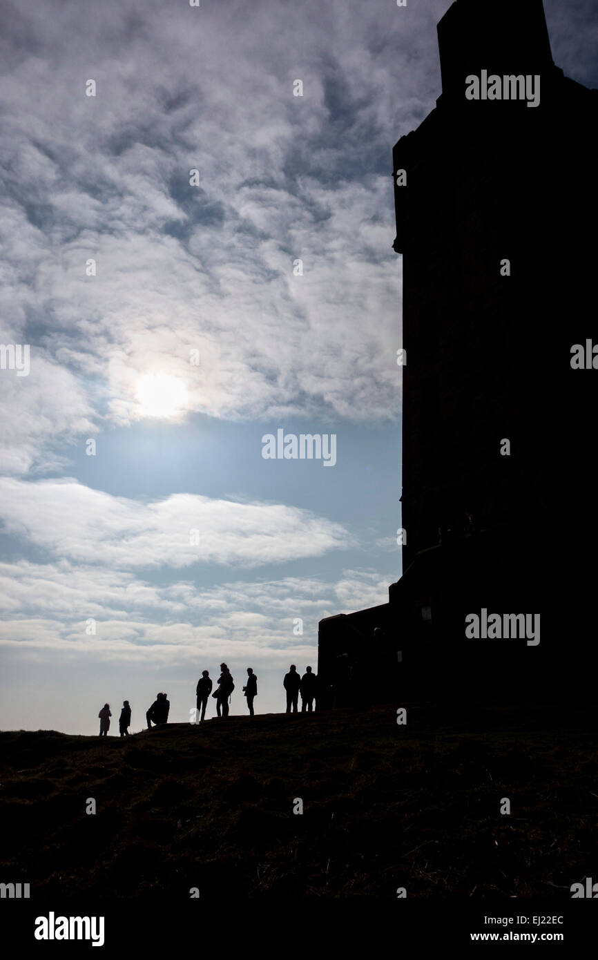 People gather on Castle Hill in Huddersfield, West Yorkshire to watch the partial solar eclipse on 20th March 2015. - Stock Image