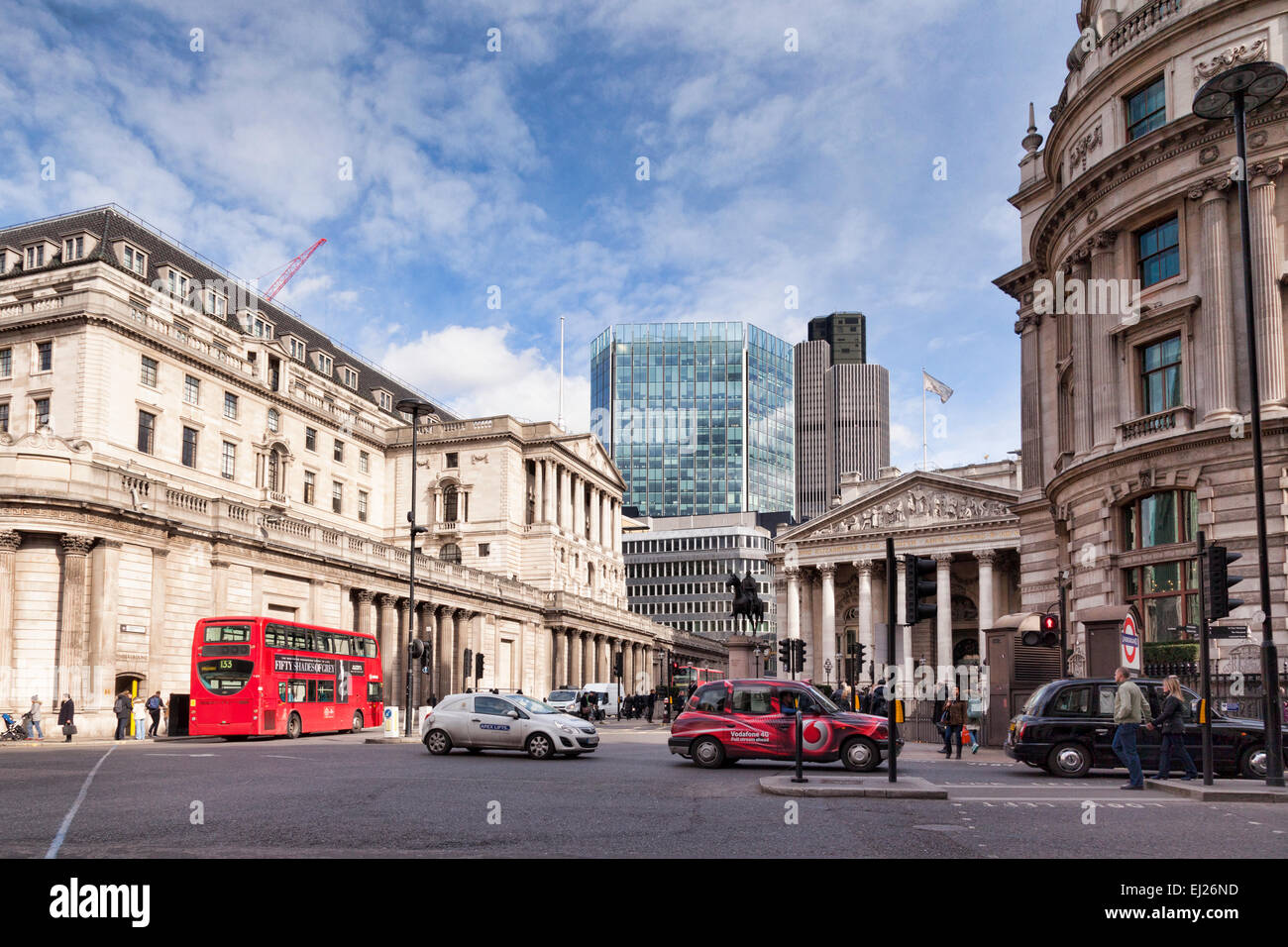 A street scene in Threadneedle Street, London, England, with the Bank of England on the left. The glass building - Stock Image