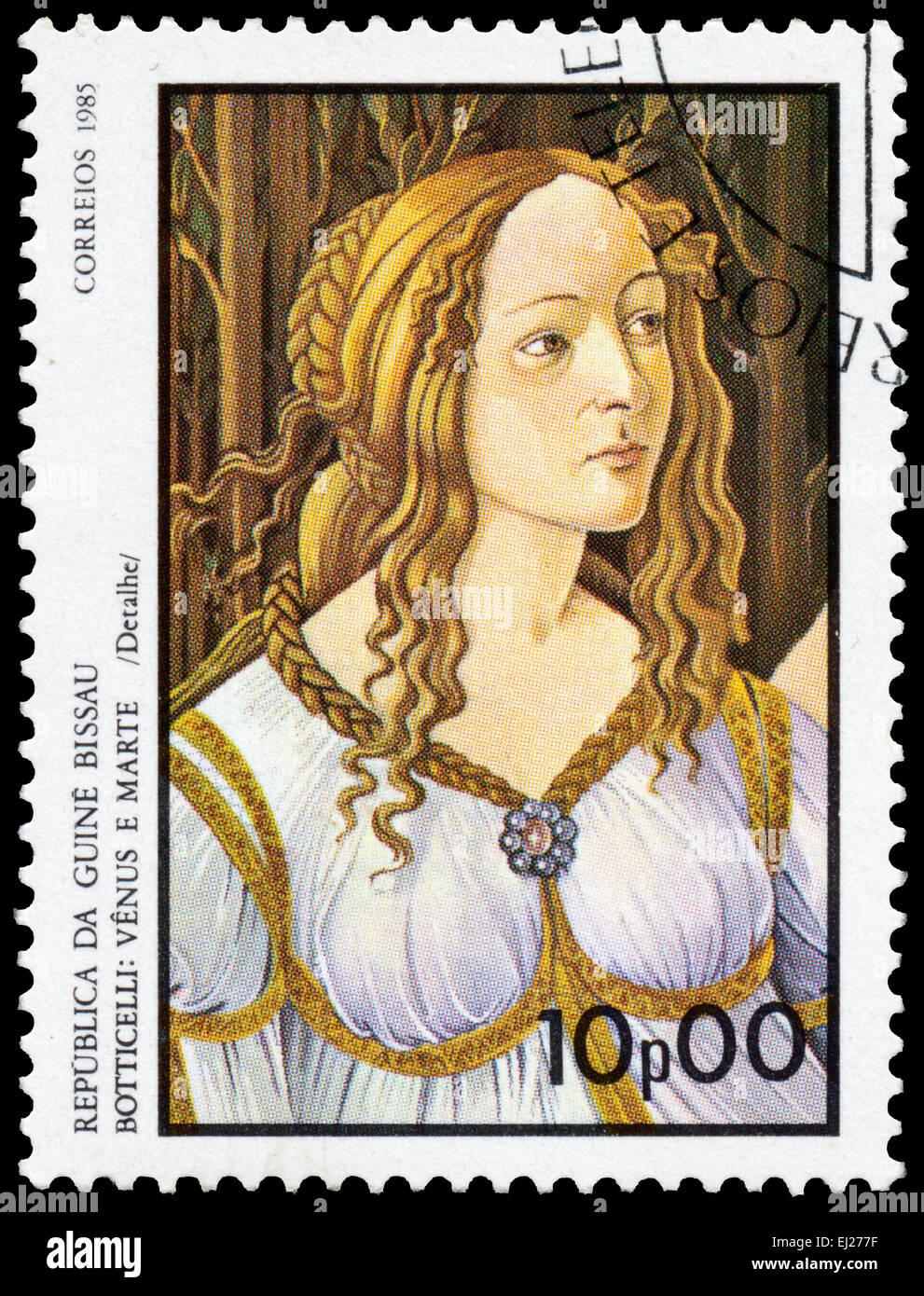 GUINEA BISSAU - CIRCA 1985: Stamp printed in Guinea-Bissau shows Venus and Mars - detail - by Botticelli, circa Stock Photo