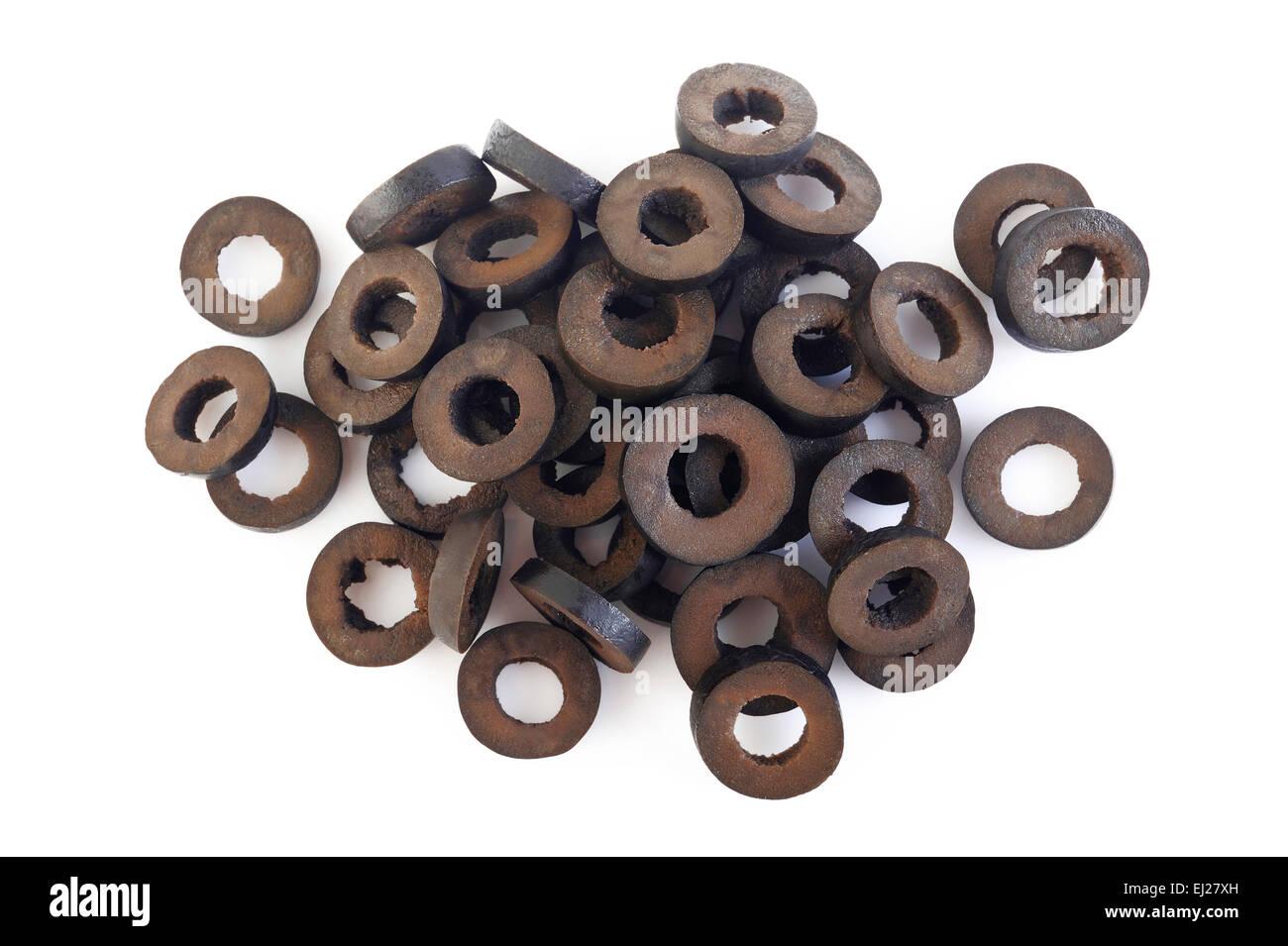 sliced black olives isolated on white background - Stock Image