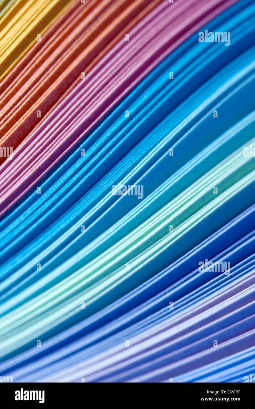 Abstract design of paper filigree strips in rainbow colors - Stock Image