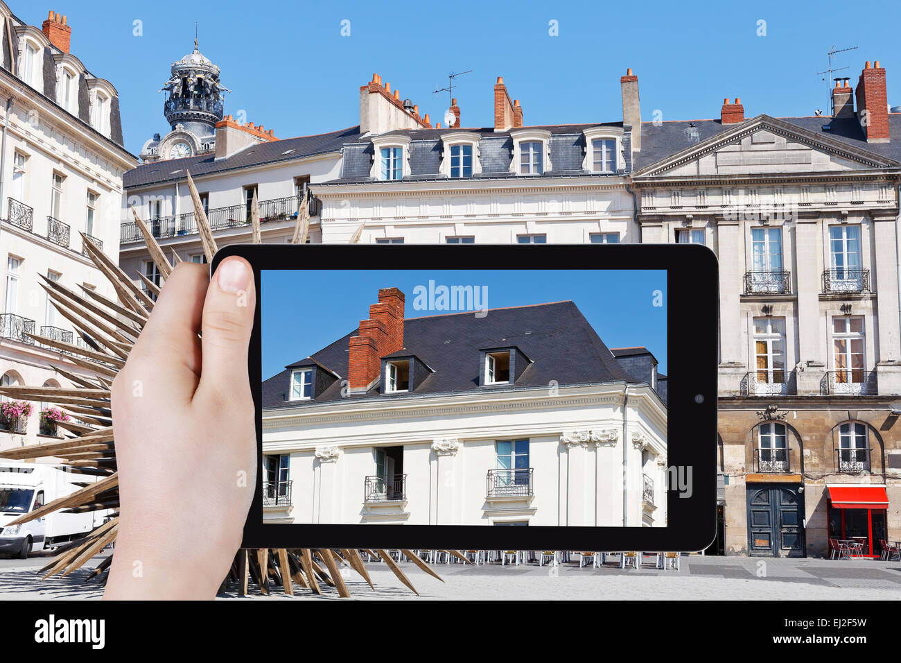 Travel Concept Tourist Takes Picture Of Facade Of Old Urban House Stock Photo Alamy