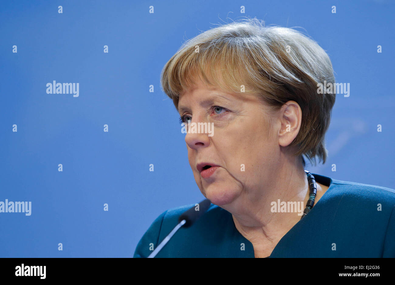 Brussels, Belgium. 20th Mar, 2015. German Chancellor Angela Merkel speaks during a press conference after the European - Stock Image