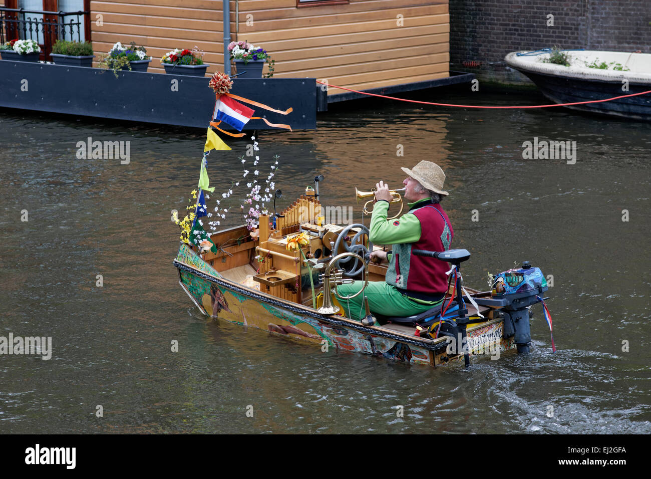 Reinier Sijpkens,  The Music Boat Man, performs in  Amsterdam, Holland - Stock Image