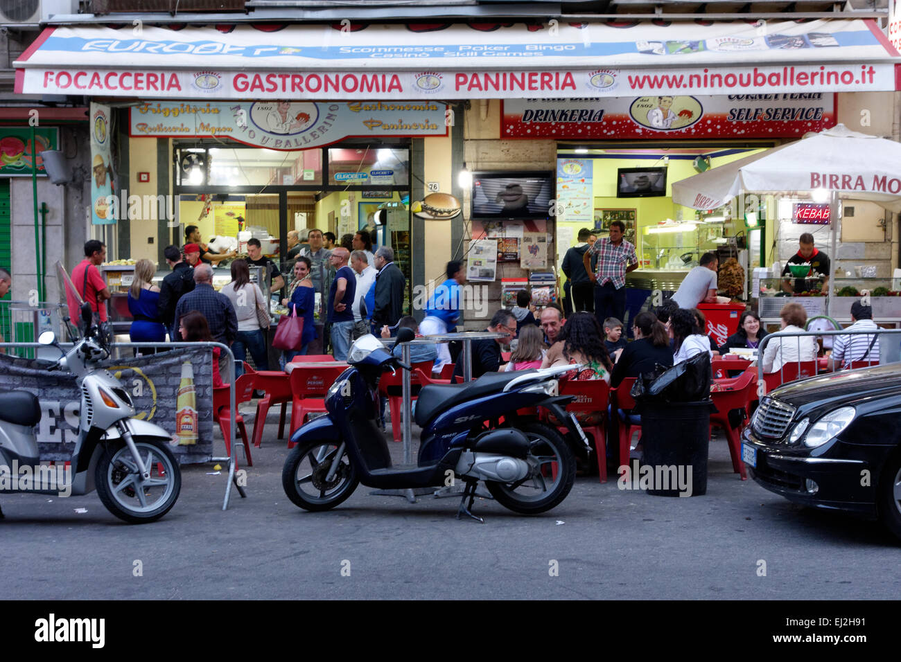 Street scene of people at restaurant in Palermo, Sicily. - Stock Image