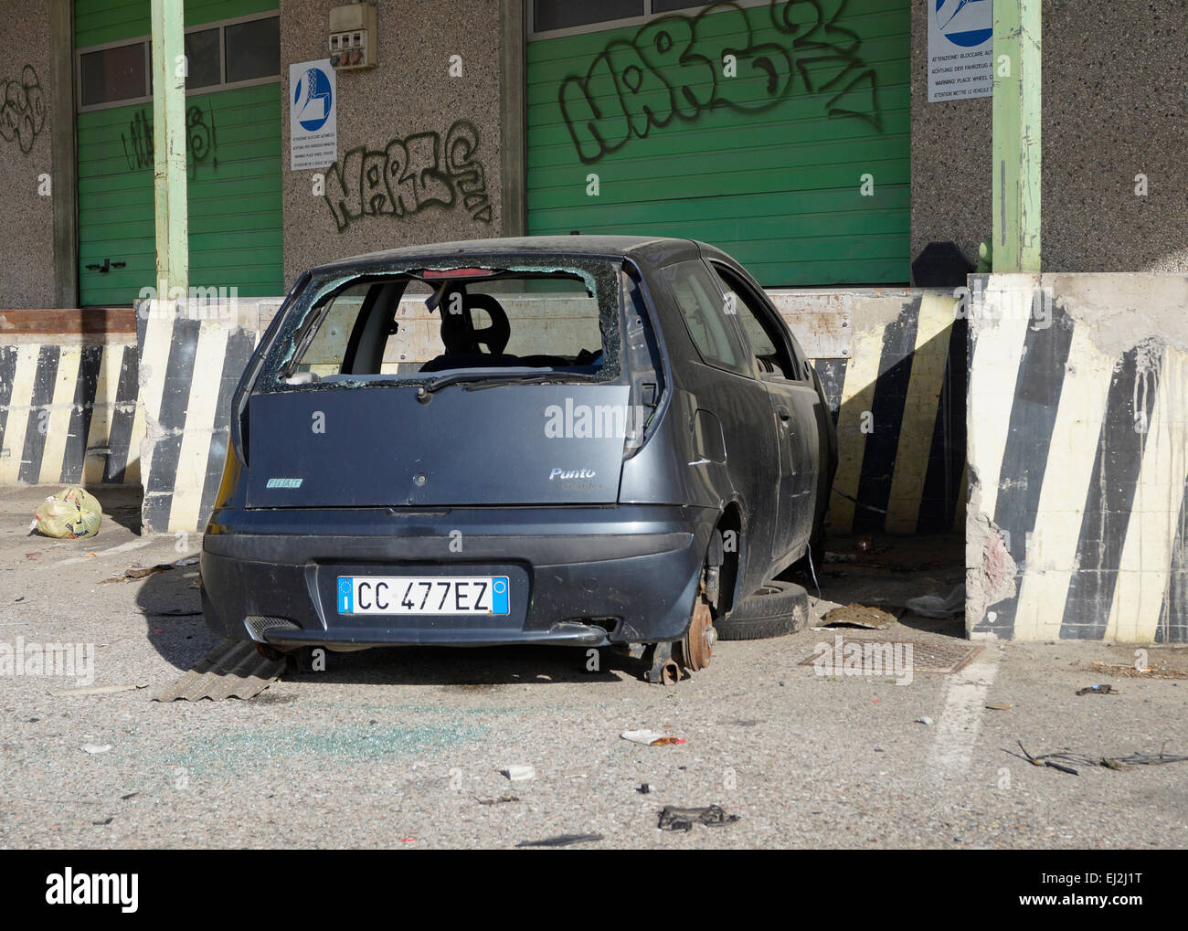 abandoned car with smashed glass, Italy - Stock Image