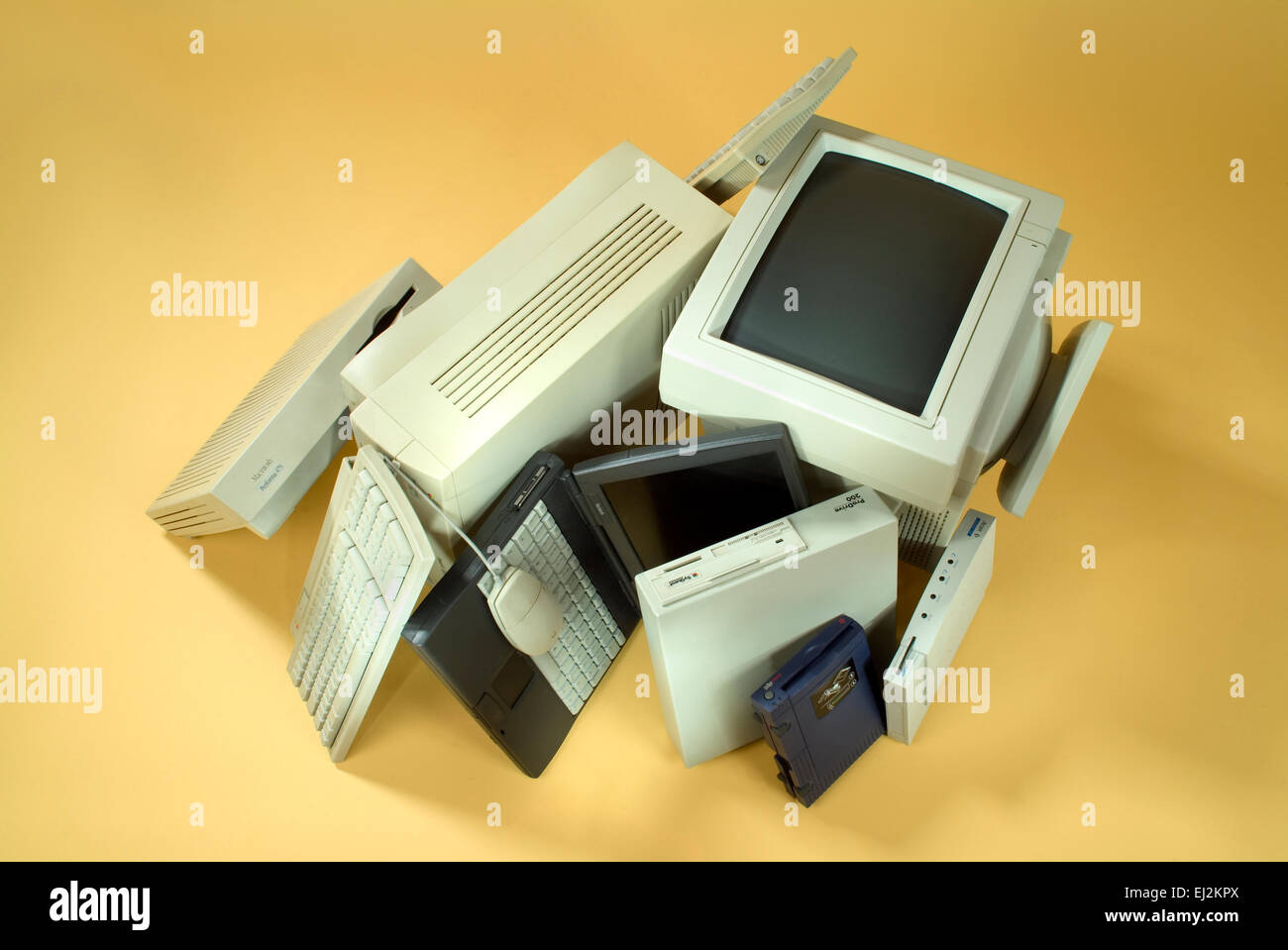 Old computer equipment on a pile. - Stock Image