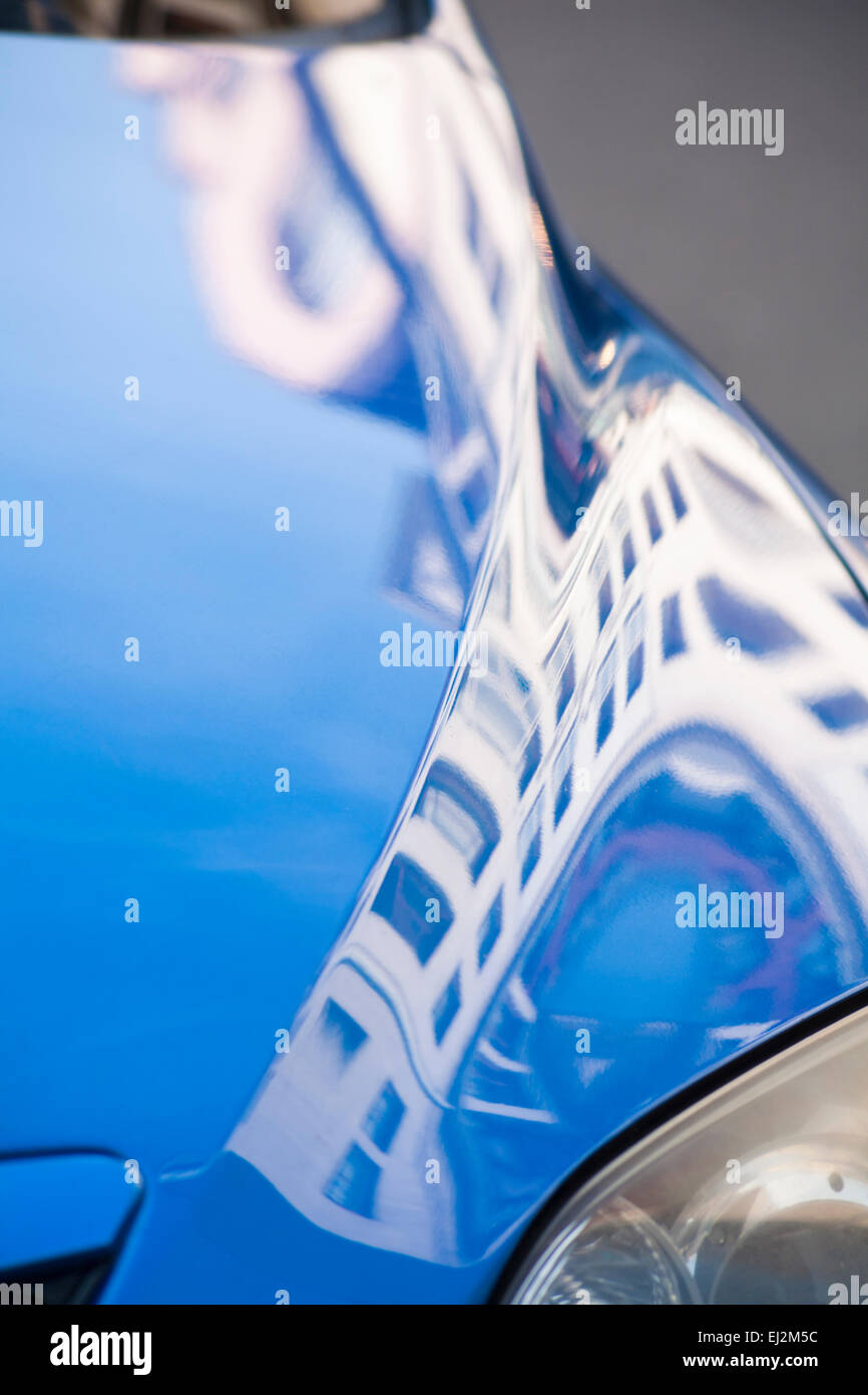distorted building reflections in car bonnet at Old Town, Krakow, Poland in September Stock Photo