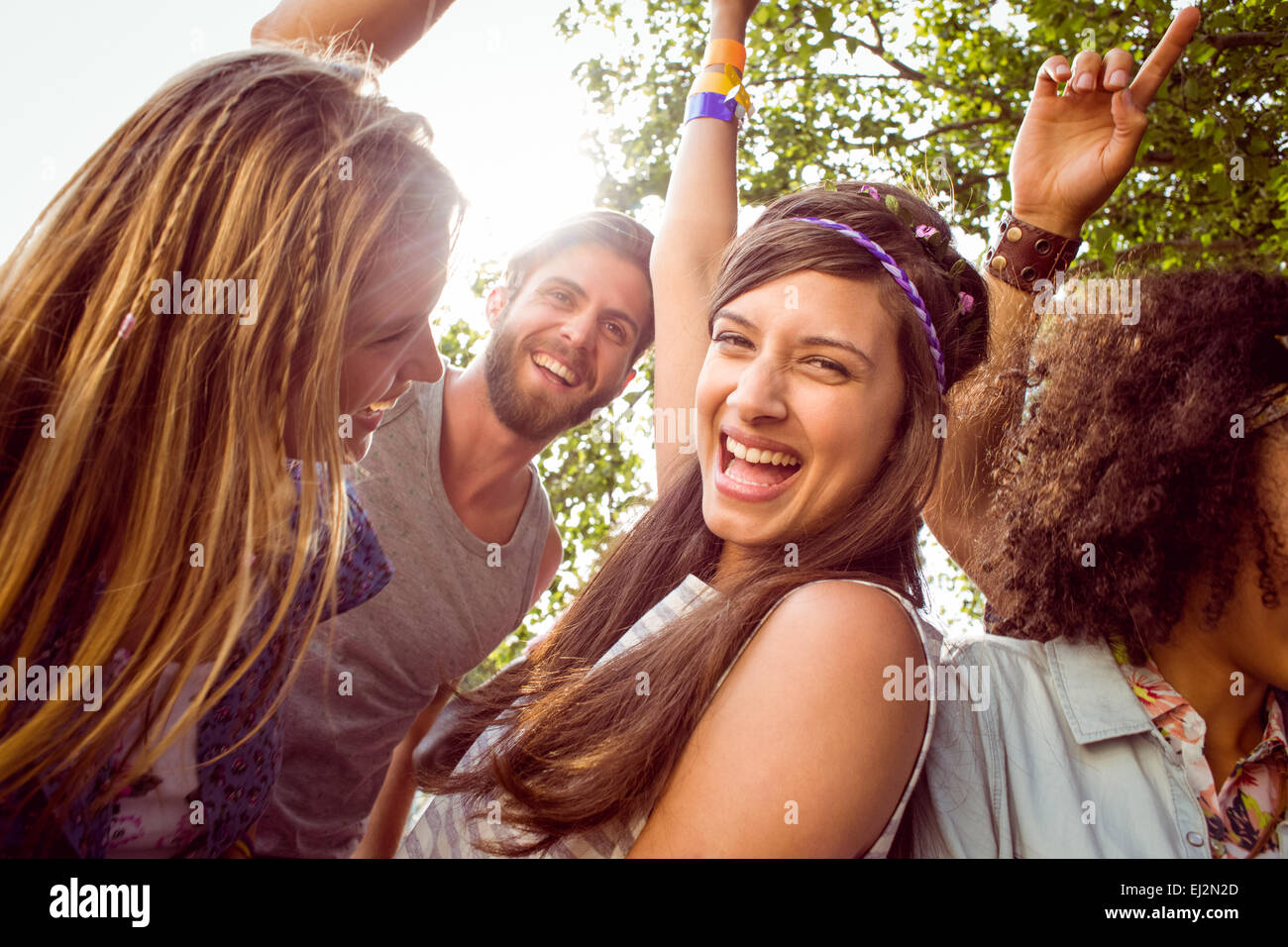 Happy hipsters dancing to the music - Stock Image