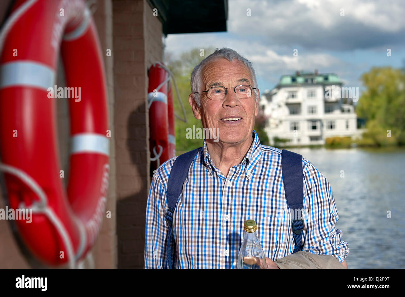 Senior is going on a boat trip - Stock Image