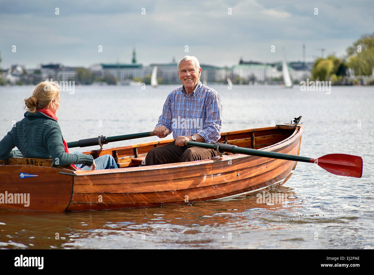 Senior and his daughter riding on a rawboat - Stock Image