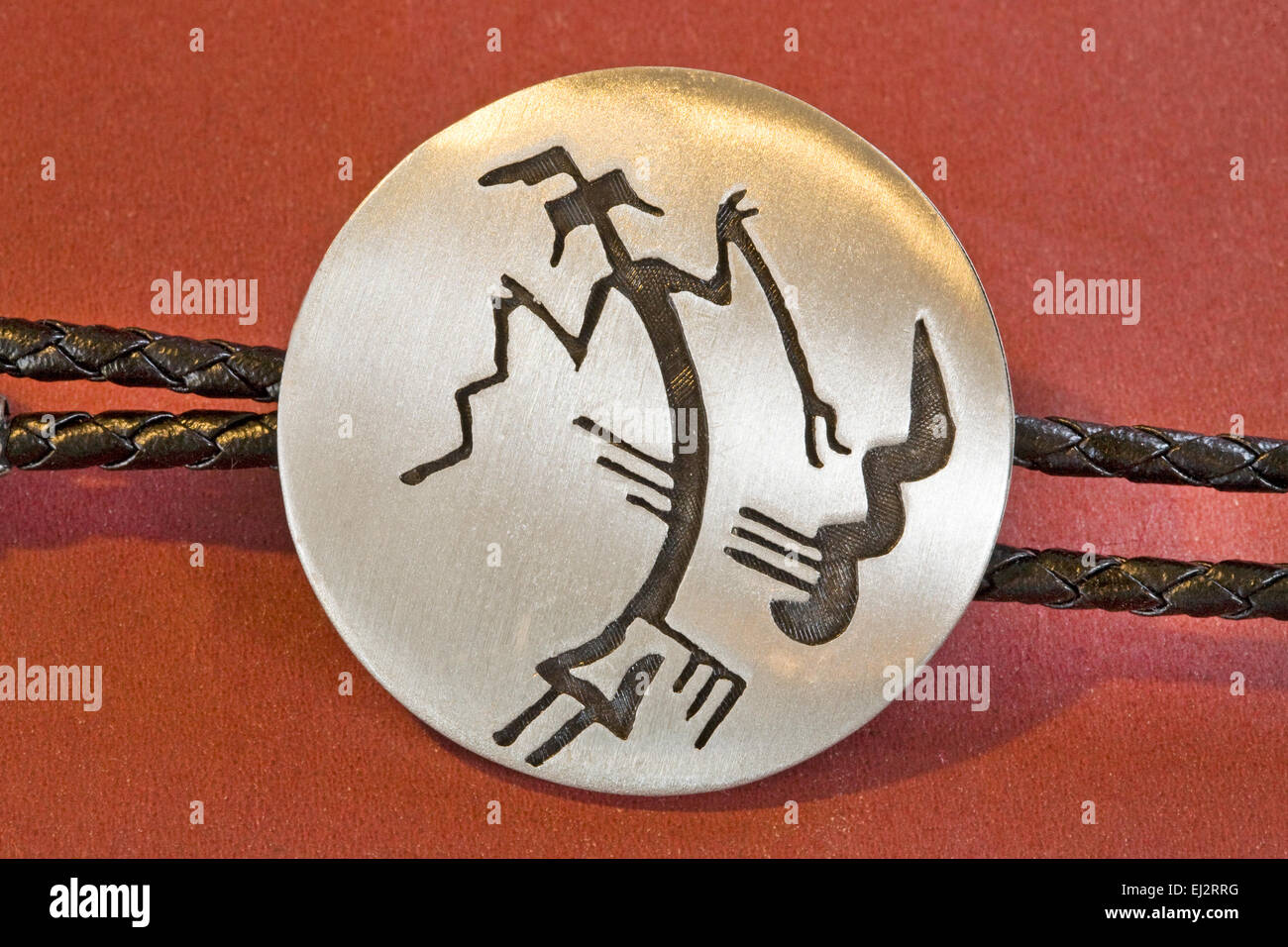 A Navajo Yei Bichei figure, or Rainbow God, on a man's bolo tie from the American Southwest. - Stock Image