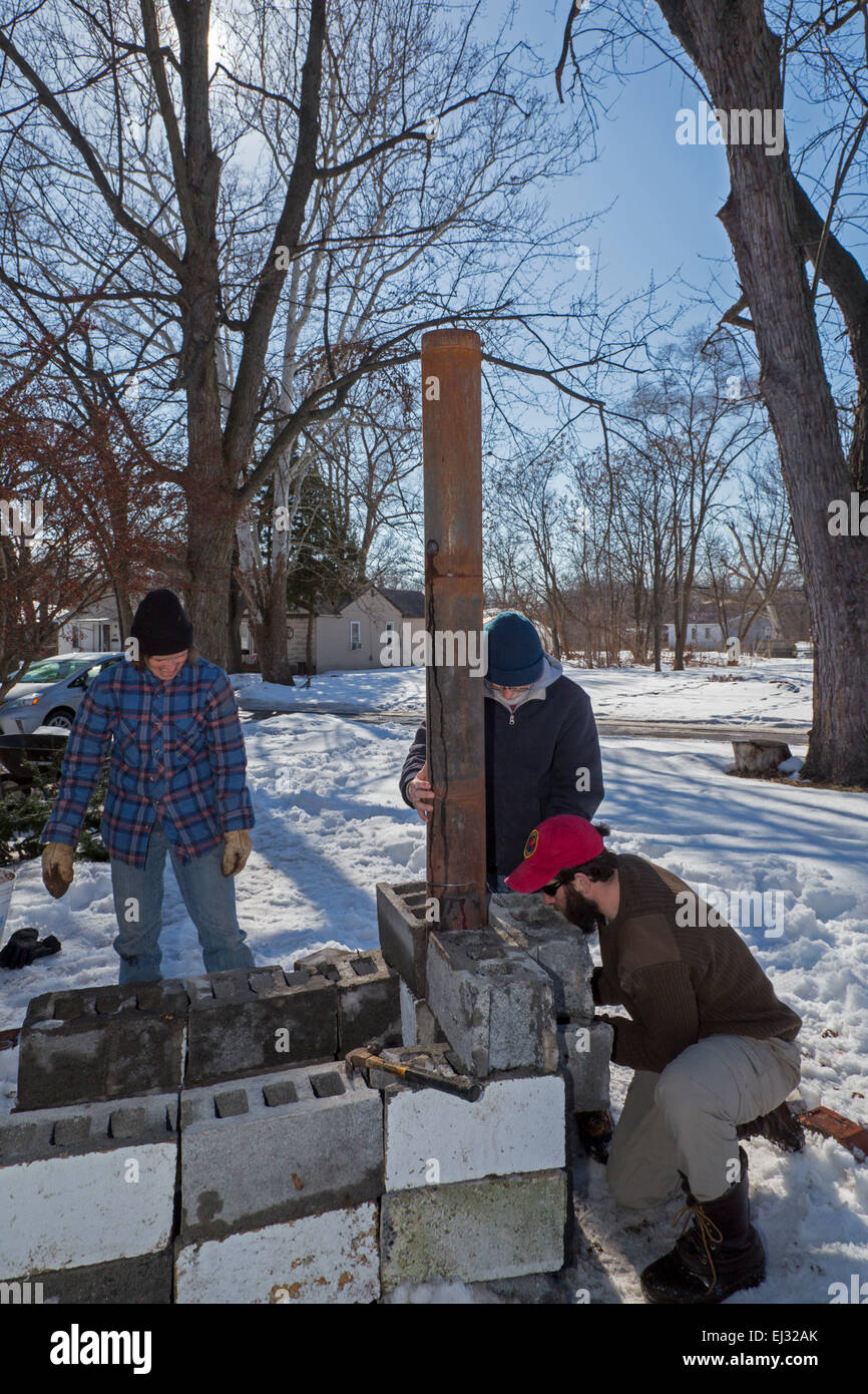 Detroit, Michigan - Urban farmers build a temporary outdoor wood stove to boil sap from sugar maple trees to make - Stock Image