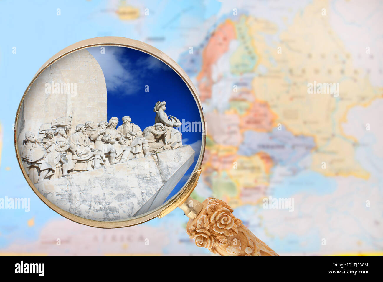 Looking in on the Explorers monument in  Portugal with a magnifying glass or loop with European map in the background - Stock Image