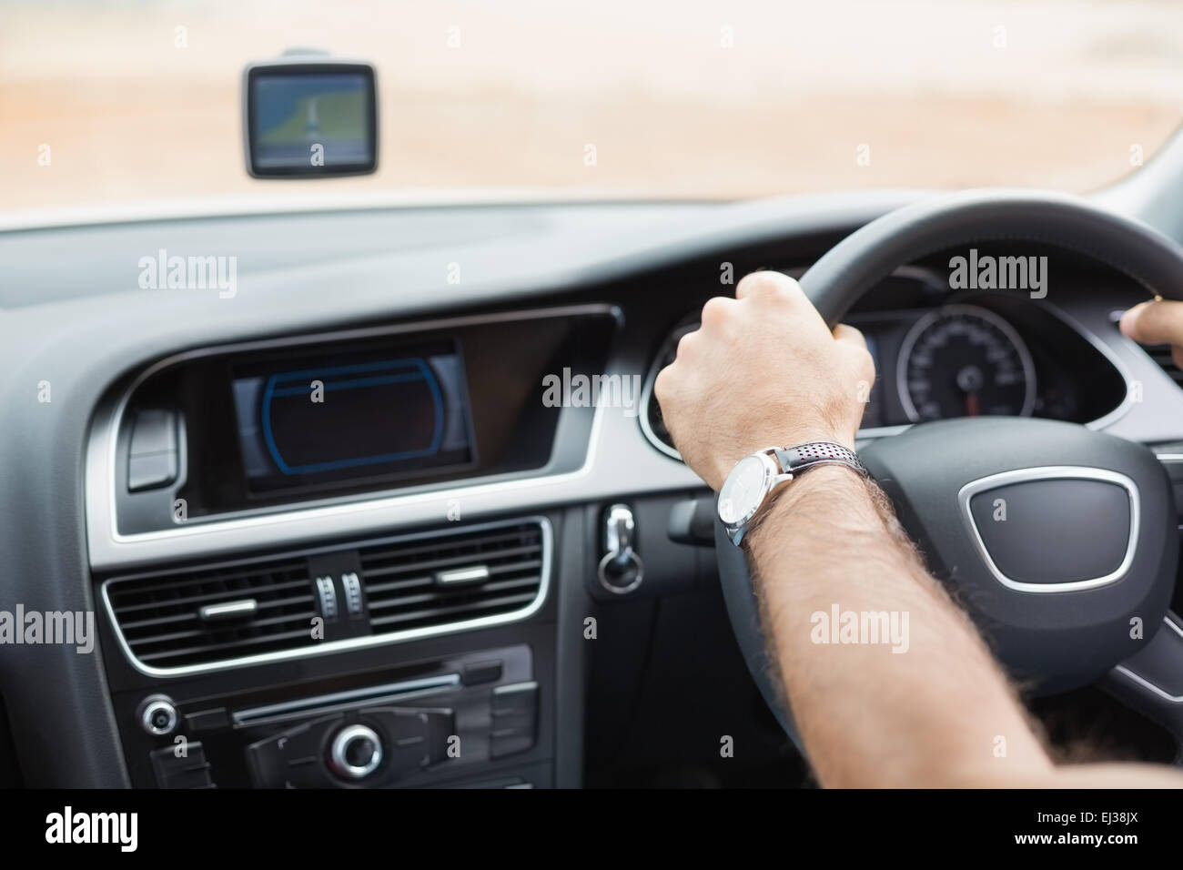 Man driving with satellite navigation system - Stock Image