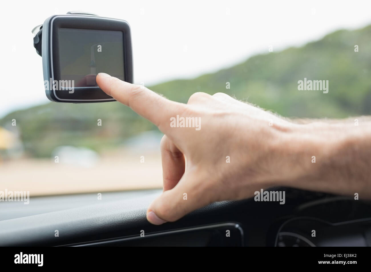 Man using satellite navigation system - Stock Image