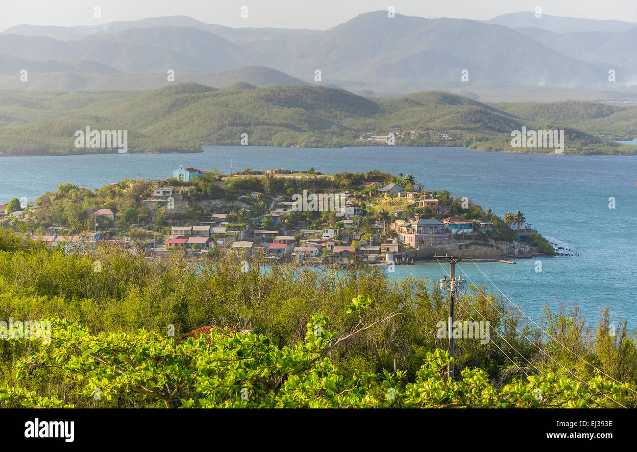 A view of the very small Granma Island from a hill on the mainland in eastern Cuba. - Stock Image