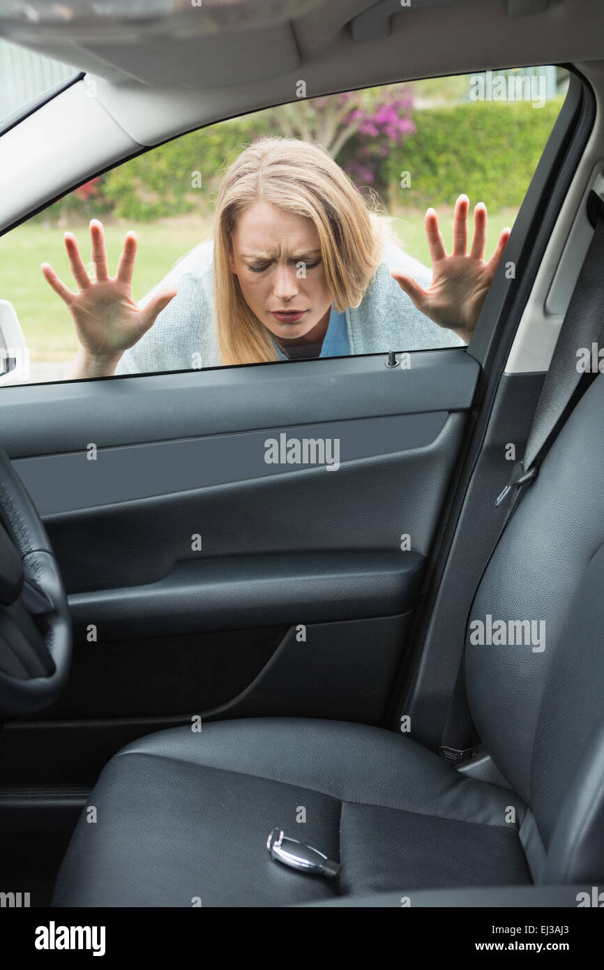 Woman forgot her key - Stock Image