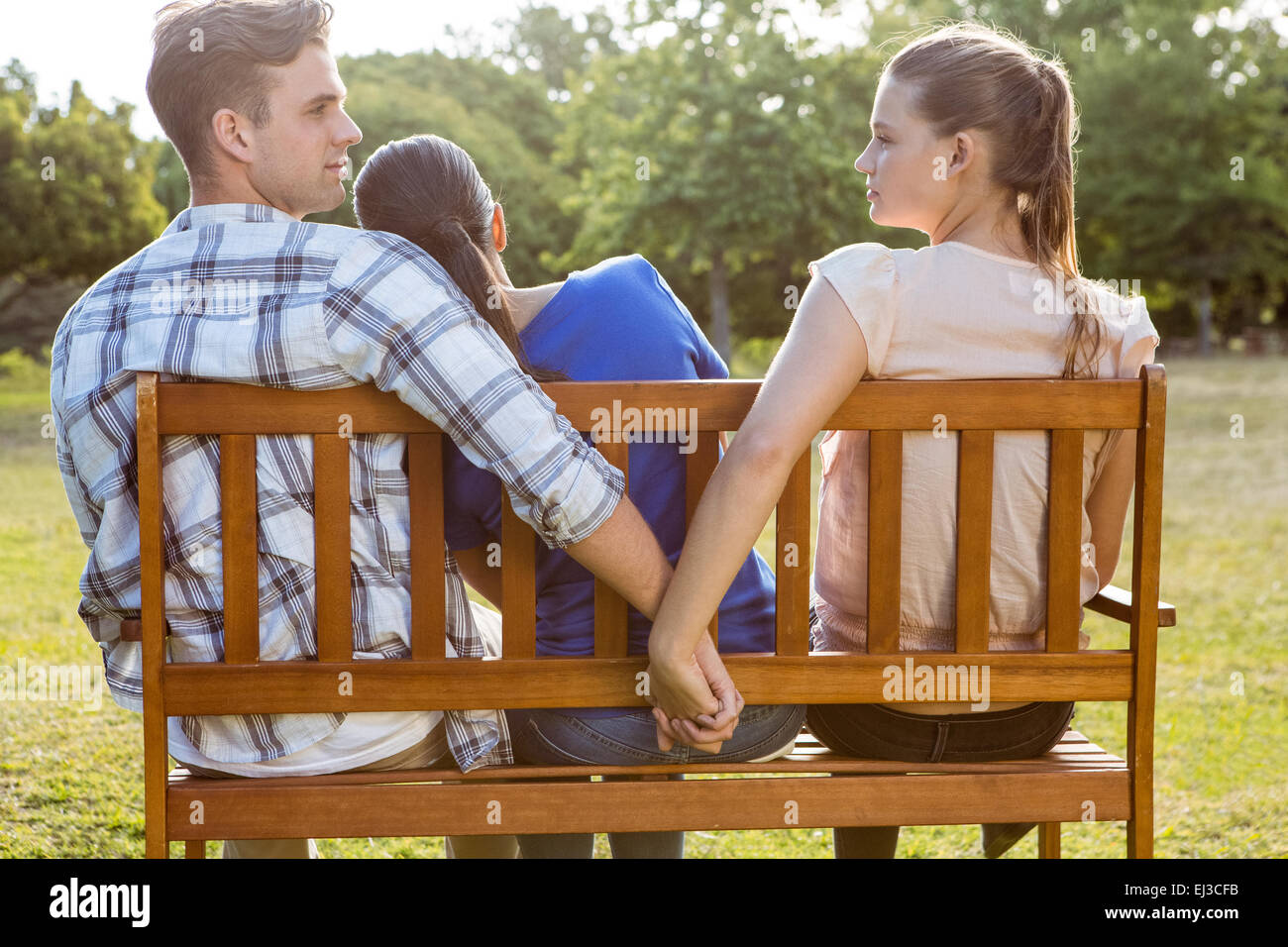 Man being unfaithful in the park - Stock Image